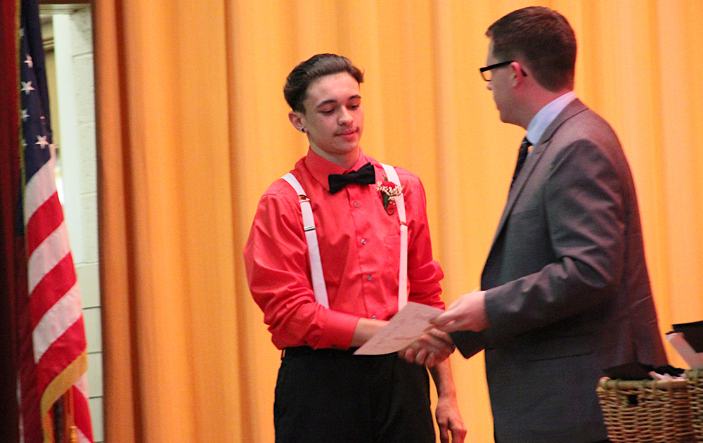 Elm Graduation 2017 — Student Gabriel Garcia receives his Cougar Pride Award from Assistant Principal Dr. Cody Huisman
