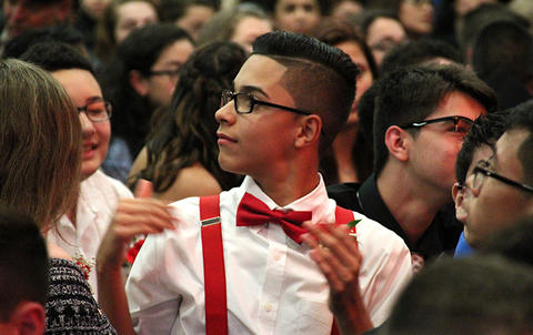 Elm Graduation 2017 — Student adjusting his bowtie