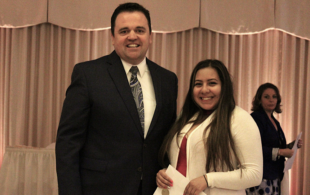 Principal James Jennings and EPHS senior Melissa Caballero, Honors: Department Achievement Award for Italian.