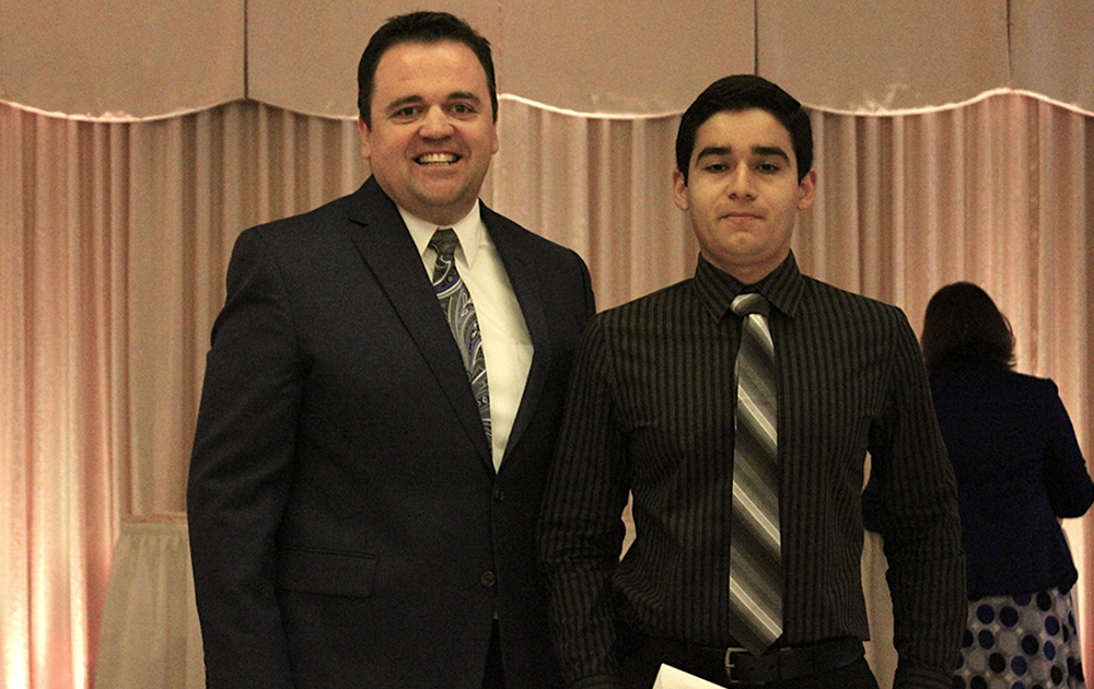 Principal James Jennings and EPHS senior Elias Arce. Honors: Top 10 percent of class, Illinois State Scholar, Presidential Scholar, John Philip Sousa Band Award, University of Chicago Odyssey Scholarship.