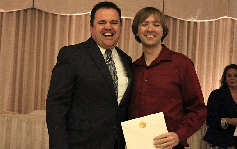Principal James Jennings and EPHS senior Christian Colon. Honors: Department Achievement Award for Spanish.