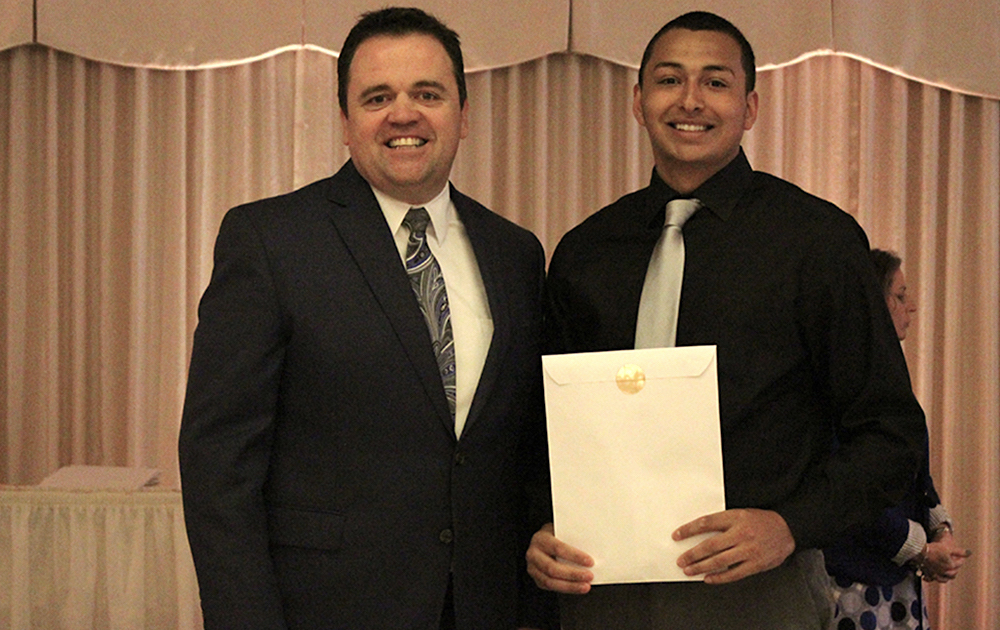Principal James Jennings and EPHS senior Daniel Gomez. Honors: Top 10 percent of class, 3.7 Honor Roll every semester, Presidential Scholar, National Honor Society, Leyden Township Carl Fiorito Scholarship.
