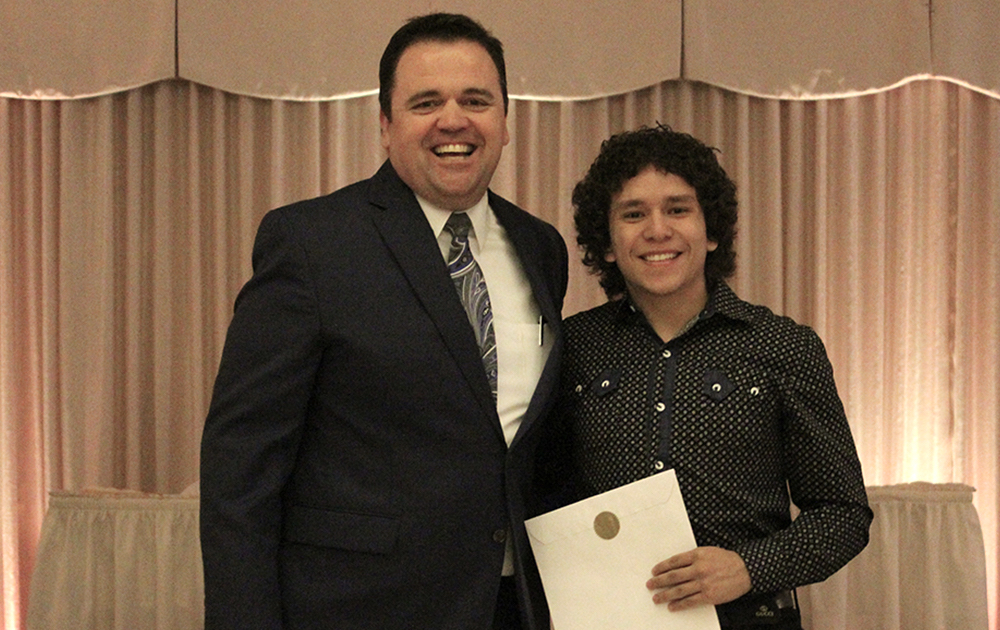 Principal James Jennings and EPHS senior Anthony Lopez. Honors: Lincoln Tech Scholarship.