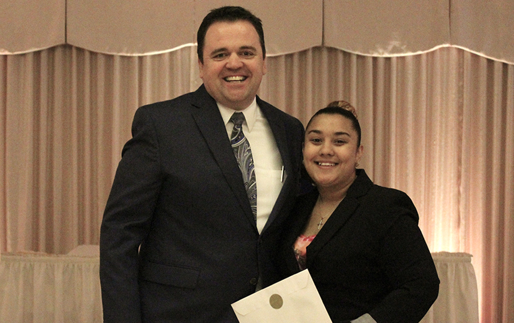 Principal James Jennings and EPHS senior Diamond Lopez. Honors: National Honor Society, Department Achievement Award for Business.
