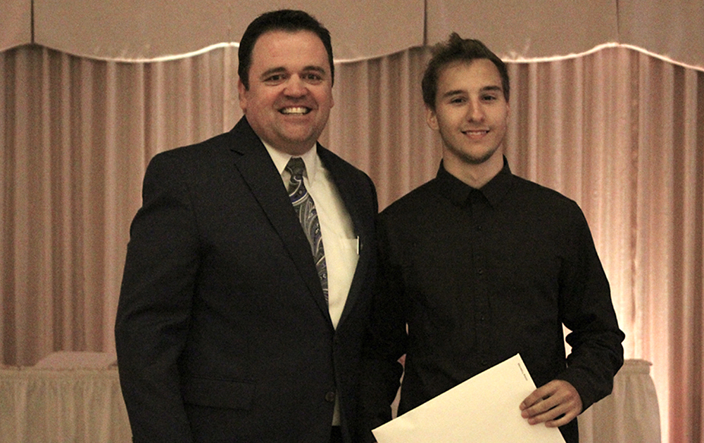 Principal James Jennings and EPHS senior Rocco Molinelli. Honors: Tiger Scholar, top 10 percent of class, 3.7 Honor Roll every semester, Illinois State Scholar, Presidential Scholar, National Honor Society, Elmwood Park Women's Club Scholarship.