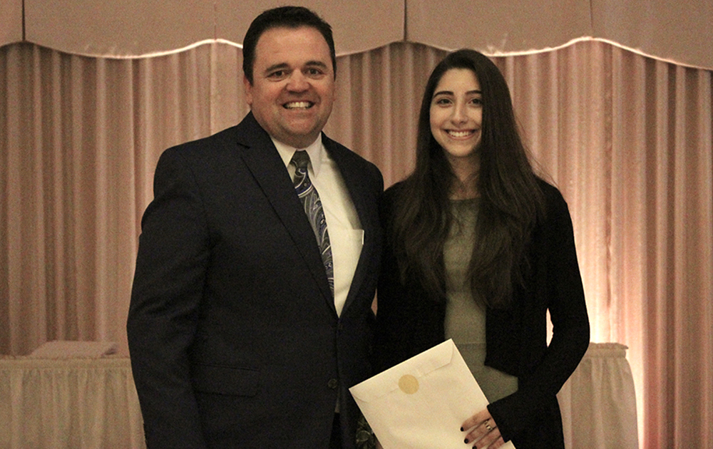Principal James Jennings and EPHS senior Sarah Ptack. Honors: Top 10 percent of class, 3.7 Honor Roll every semester, Illinois State Scholar, Presidential Scholar, Ida Brechtel Scholarship, Dominican Presidential Scholarship.