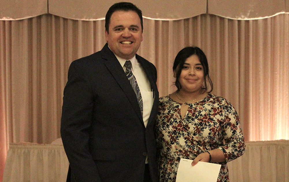 Principal James Jennings and EPHS senior Desiree Reyes. Honors: National Honor Society, Elmwood Park Women's Club Scholarship, James A. White Scholarship, Dominican Presidential Scholarship.