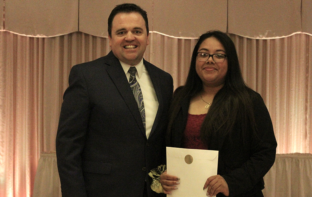 Principal James Jennings and EPHS senior Itzel Rios. Honors: Presidential Scholar.