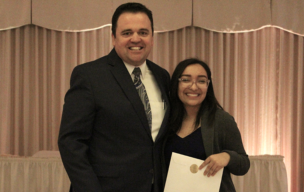 Principal James Jennings and EPHS senior Elizabeth Rodriguez. Honors: International Thespian Society, Thespian of the Year Recipient, Outstanding Senior Vocalist, North Central College Theatre Scholarship.