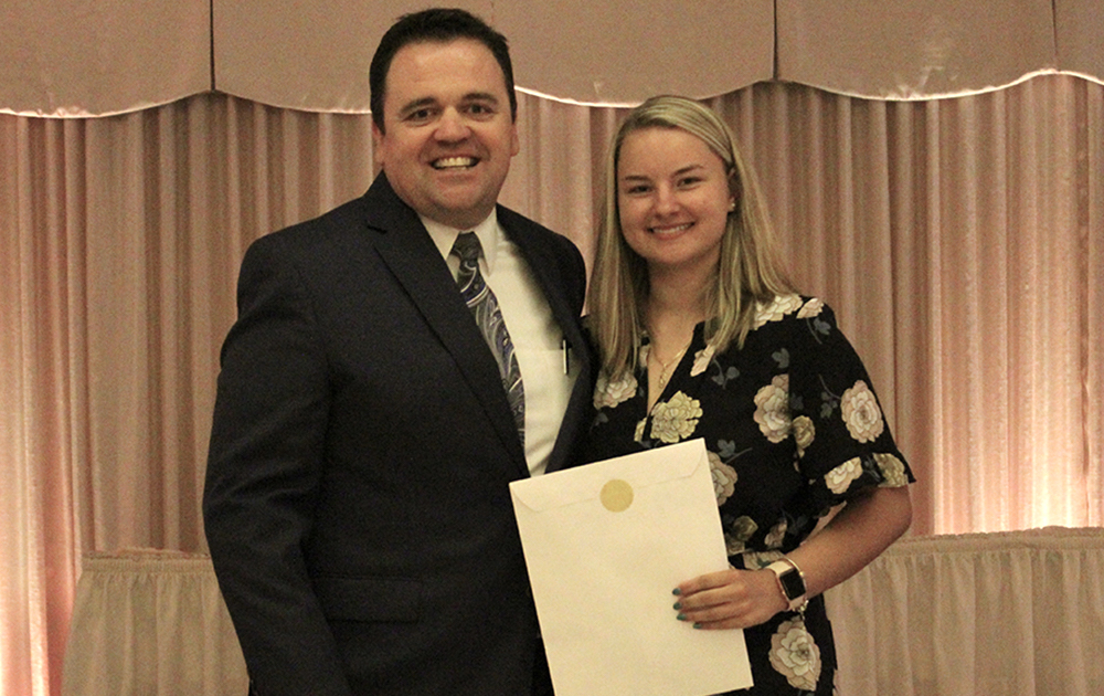 Principal James Jennings and EPHS senior Katarzyna Skwiot. Honors: Presidential Scholar, National Honor Society, Gottlieb Memorial Hospital Auxiliary/Medical Staff Scholarship, Loyola University Damen Scholarship.