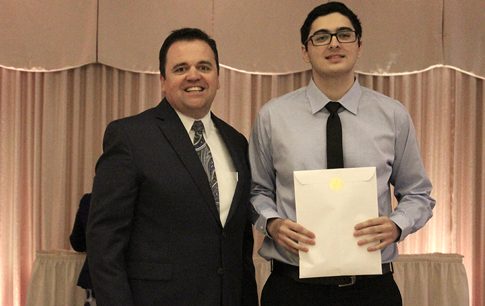 Principal James Jennings and EPHS senior Kevin Taha. Honors: Tiger Scholar, top 10 percent of class, 3.7 Honor Roll every semester, Illinois State Scholar, Presidential Scholar.