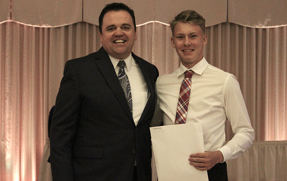Principal James Jennings and EPHS senior Jakub Zwierzynski. Honors: Tiger Scholar, top 10 percent of class, 3.7 Honor Roll every semester, Illinois State Scholar, Presidential Scholar, National Honor Society, Chick Evans Caddie Scholarship Recipient.