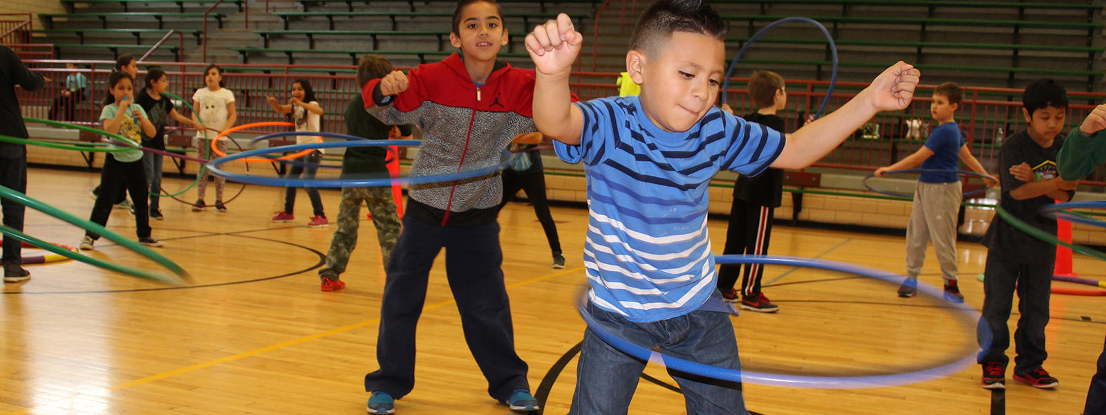 John Mills students do the Hula Hoop during PE class.