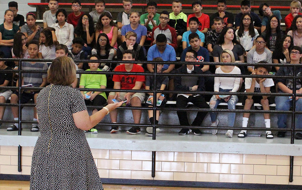 Principal Dr. Kathleen Porreca addresses Elm students at Elm Gym on the first day of school, Aug. 16, 2017.