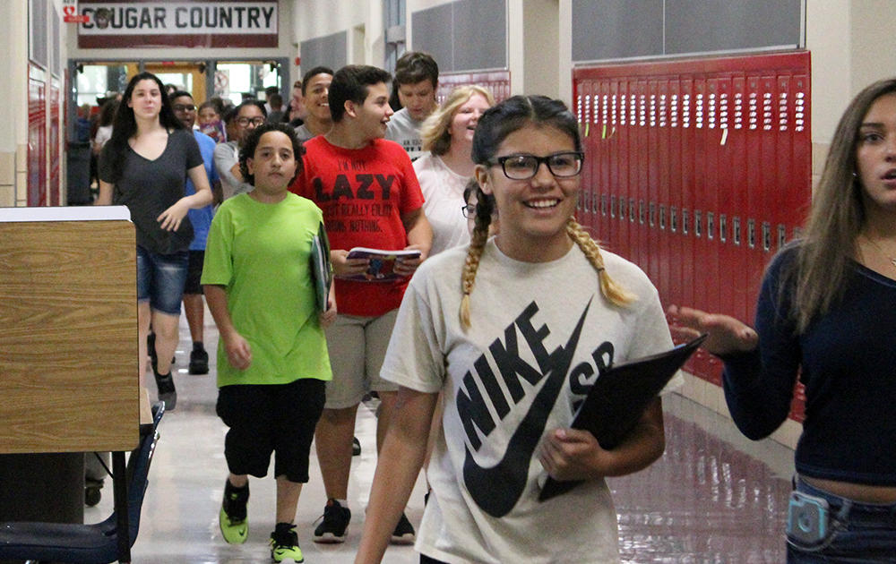 Elm students walk down the hallway on the first day of school, Aug. 16, 2017.