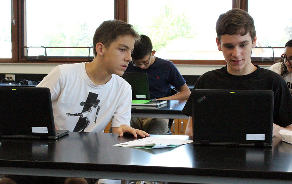 Two EPHS consult with each other during Google circuit training.