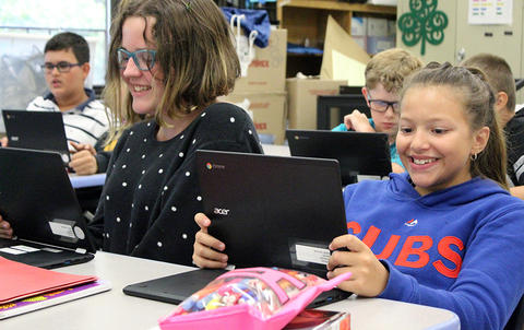Two Elm students share a laugh during Google circuit training.