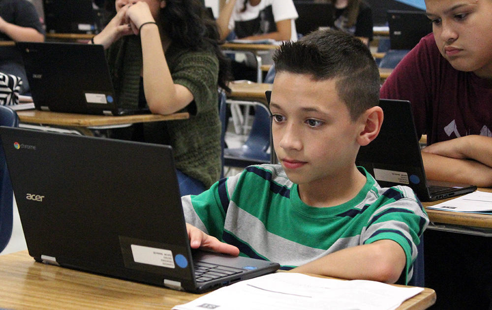 An Elm student concentrates on his laptop screen during Google circuit training.