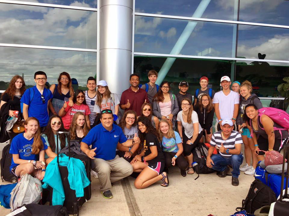 EPHS students and chaperones gather at an airport during their Costa Rica summer trip.