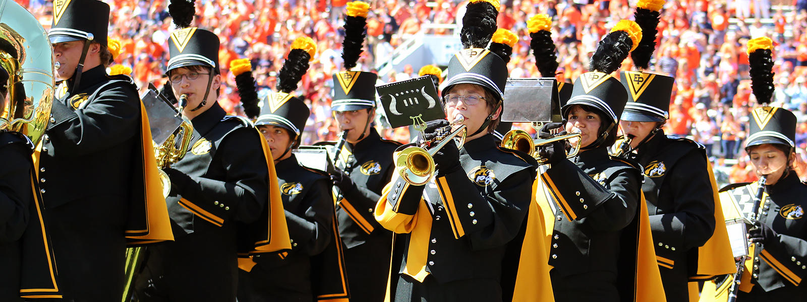 The EPHS Marching Tigers perform with the U of I Marching Illini during halftime of the Illinois football season opener.
