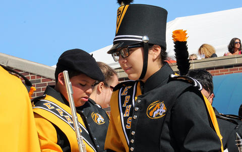 Several EPHS band members set their instruments down in the stands at U of I Memorial Stadium as they wait for the start of Illinois Band Day.