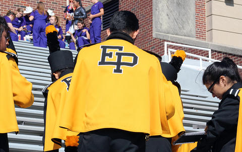 EPHS musicians get ready to leave the stands at Memorial Stadium in search of refreshments.