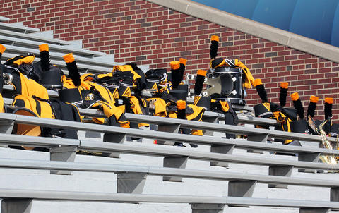 A closeup of EPHS Band instruments and uniforms as they sit on the stands at Memorial Stadium while band members are elsewhere in search of refreshments.
