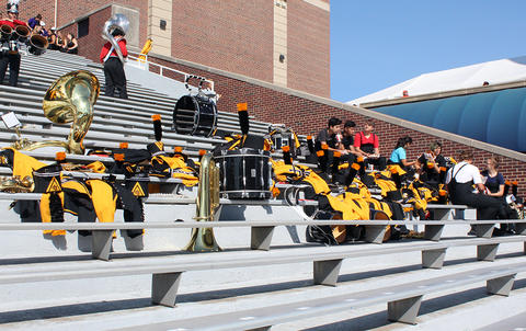EPHS Band instruments and uniforms sit on the stands at Memorial Stadium while band members are elsewhere in search of refreshments.