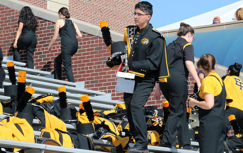 An EPHS band member sets his equipment down in the stands at Memorial Stadium before he leaves in search of refreshments.