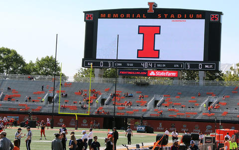 "An electronic scoreboard displays a giant ""I"" at Memorial Stadium prior to the start of the Sept. 2 football game between Illinois and Ball State."