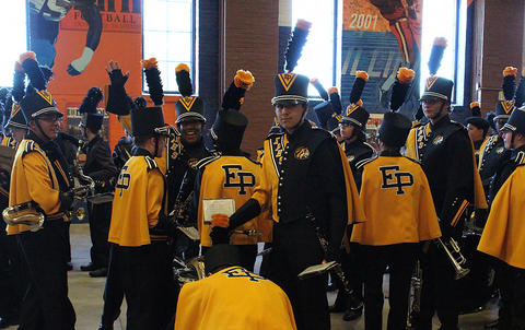 EPHS Band members assemble inside Memorial Stadium as they prepare to march onto the field for their halftime performance with the Marching Illini.