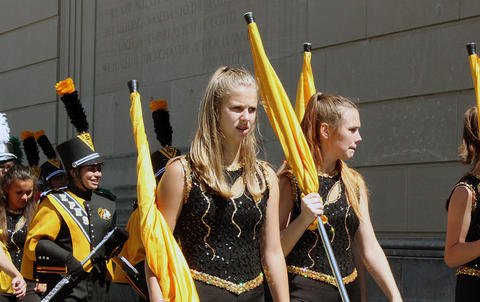 Members of the EPHS Color Guard march outside Memorial Stadium on their way to the playing field for their halftime performance.