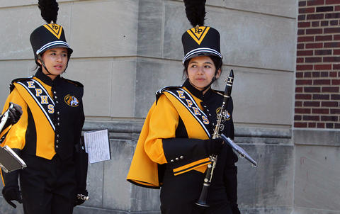 Two EPHS Band members march outside Memorial Stadium on their way to the playing field for their halftime performance.
