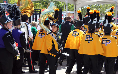 An EPHS Band member turns around and looks behind her as she and her bandmates march outside Memorial Stadium on their way to the playing field for their halftime performance.