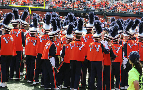 Members of the University of Illinois Marching Illini get ready to go onto the field at halftime for Illinois Band Day.