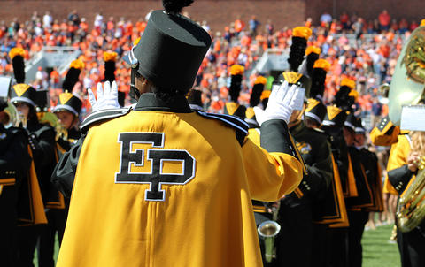 A view from behind the EPHS Band student conductor as he leads the band during halftime at Memorial Stadium.