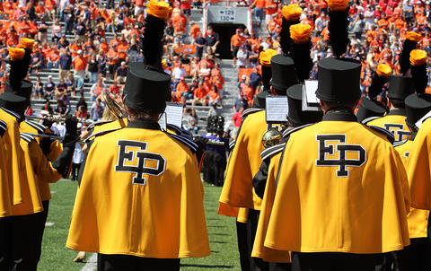 A view from behind of the EPHS Band performing during halftime at Memorial Stadium. They are facing west in formation.