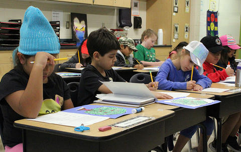 Elmwood Elementary students seated in class wear hats to support the Hats for Houston fundraiser.