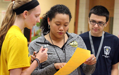 Student club leaders look over a handout during EPHS Open House 2017.