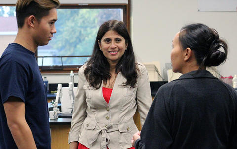 Science teacher Ms. Falguni Soni meets with a student and parents during EPHS Open House 2017.