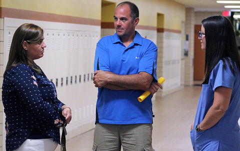 An EPHS teacher speaks with parents during Open House 2017.