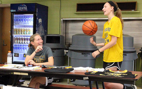 Two female basketball players are ready to answer questions in the cafeteria during EPHS Open House 2017.