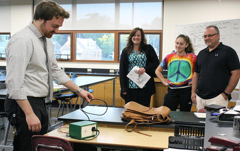 Science teacher Mr. Christian Rosenzweig demonstrates a scientific instrument to parents and their student during EPHS Open House 2017.