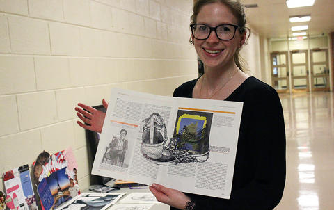 Art teacher Ms. Sarah Heflin displays student work in the hallway during EPHS Open House 2017.