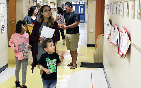 Students and parents walk through the main hall while attending the Early Childhood Center's Fall 2017 Open House.