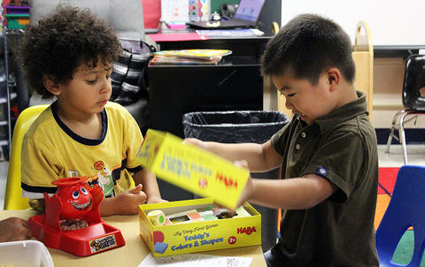 Students play in a classroom while attending the Early Childhood Center's Fall 2017 Open House.