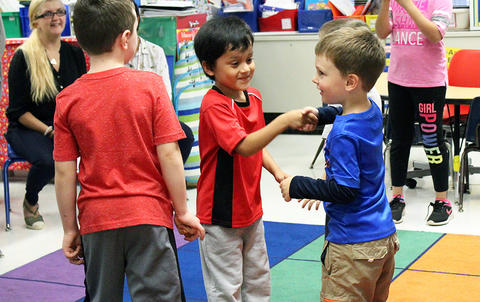 Students shake hands during an activity at the Early Childhood Center's Fall 2017 Open House.