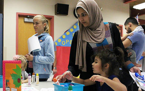 Students and parents do an art activity while attending the Early Childhood Center's Fall 2017 Open House.