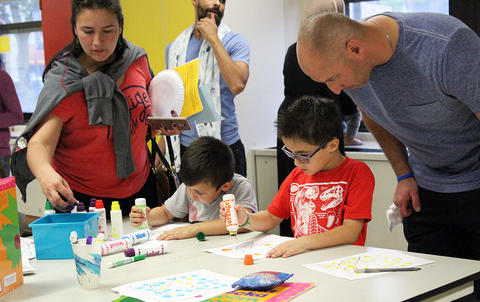 Students do an art activity with their parents while attending the Early Childhood Center's Fall 2017 Open House.
