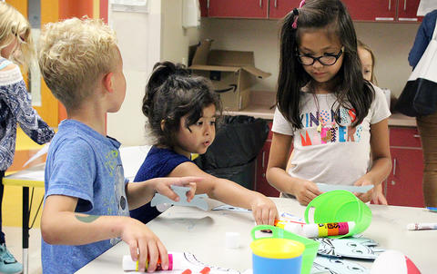 Students do an art activity while attending the Early Childhood Center's Fall 2017 Open House.